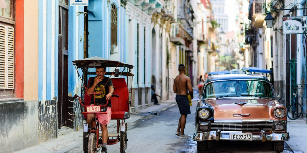 cuban man on a bicycle taxi