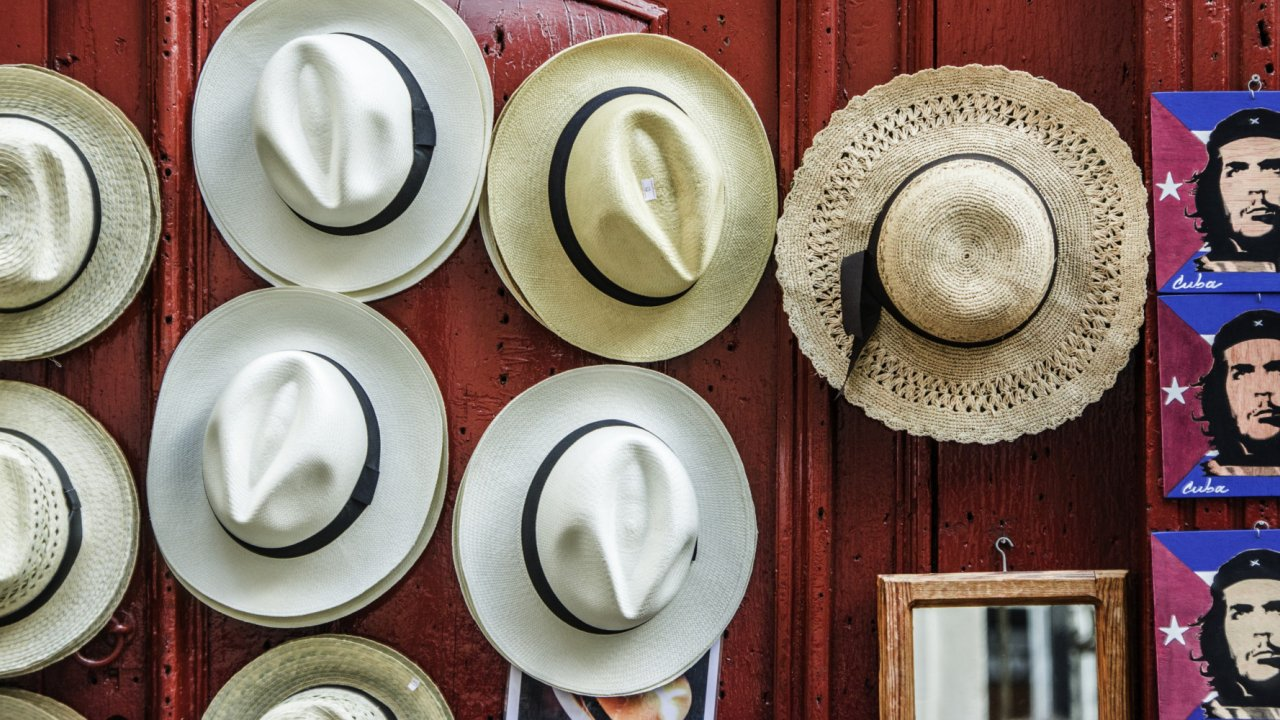 hats on a door in cuba