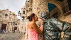 woman kissing statue cuba